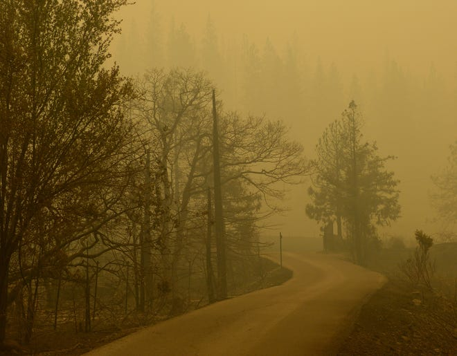 A heavy blanket of smoke hung over a Pollard Flat neighborhood after the Delta Fire ripped through it last week.