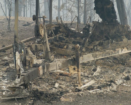 This is all that's left of a boat and trailer in the Pollard Flat area after the Delta Fire incinerated them.