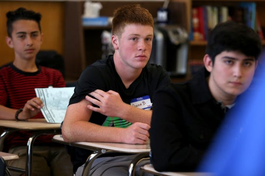 Max Baez, from left, Quinn Bach and Victor Avalos sit in a class on the first day of school of ninth graders at McNary High School in Keizer Sep. 4, 2018.