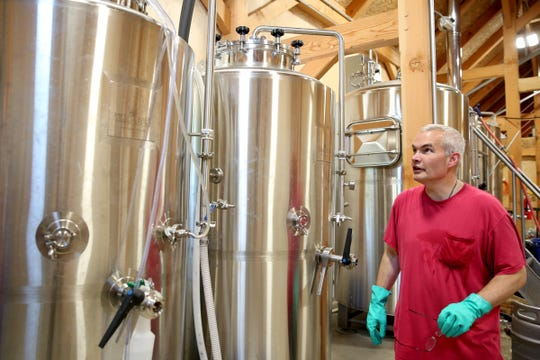 Father Jacob Stronach monitors the brewing process at the Benedictine Brewery in Mt. Angel on Wednesday, Sep. 5, 2018. The brewery, operated by the monks of Mount Angel Abbey, opens September 22.