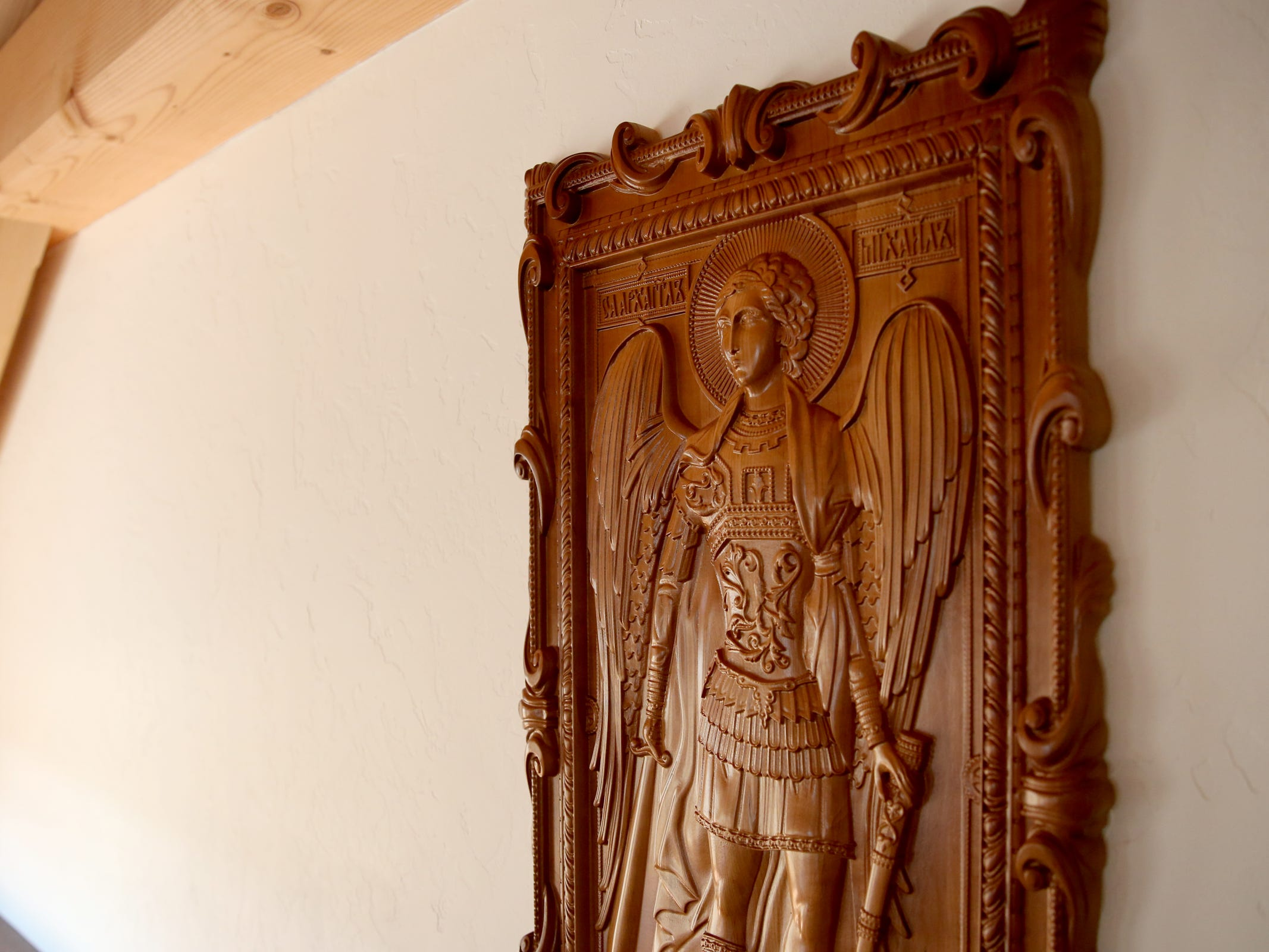 A carving of St. Michael hangs on the taproom wall at the Benedictine Brewery in Mt. Angel on Wednesday, Sep. 5, 2018. The brewery, operated by the monks of Mount Angel Abbey, opens September 22.