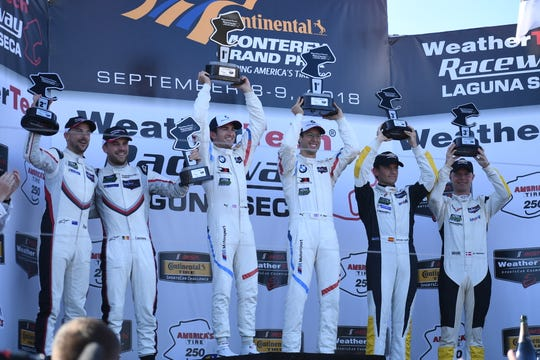 The podium for the GT Le Mans class, from left: Earl Bamber and Laurens Vanthoor (no. 912, Porsche GT Team) in second, Connor De Phillippi and Alexander Sims (no. 25, BMW Team RLL) in first and Antonio Garcia and Jan Magnussen (no. 3, Corvette Racing) in third.