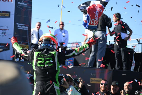 No. 22 Tequila Petron ESM driver Pipo Derani celebrates his comeback victory from as low as 23rd overall in the America's Tire 250 at WeatherTech Raceway Laguna Seca.
