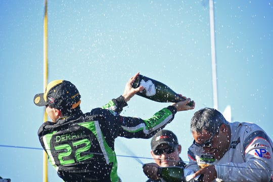 Race winner Pipo Derani (left) sprays champagne on third-place finisher Juan Pablo Montoya.