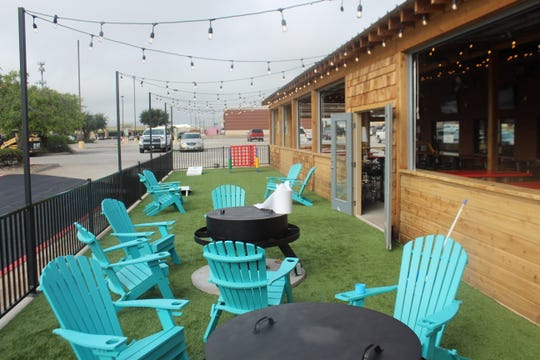 A turf patio at Fuzzy's Taco Shop, 4333 Sherwood Way, where people can play cornhole or sit by a fire pit.