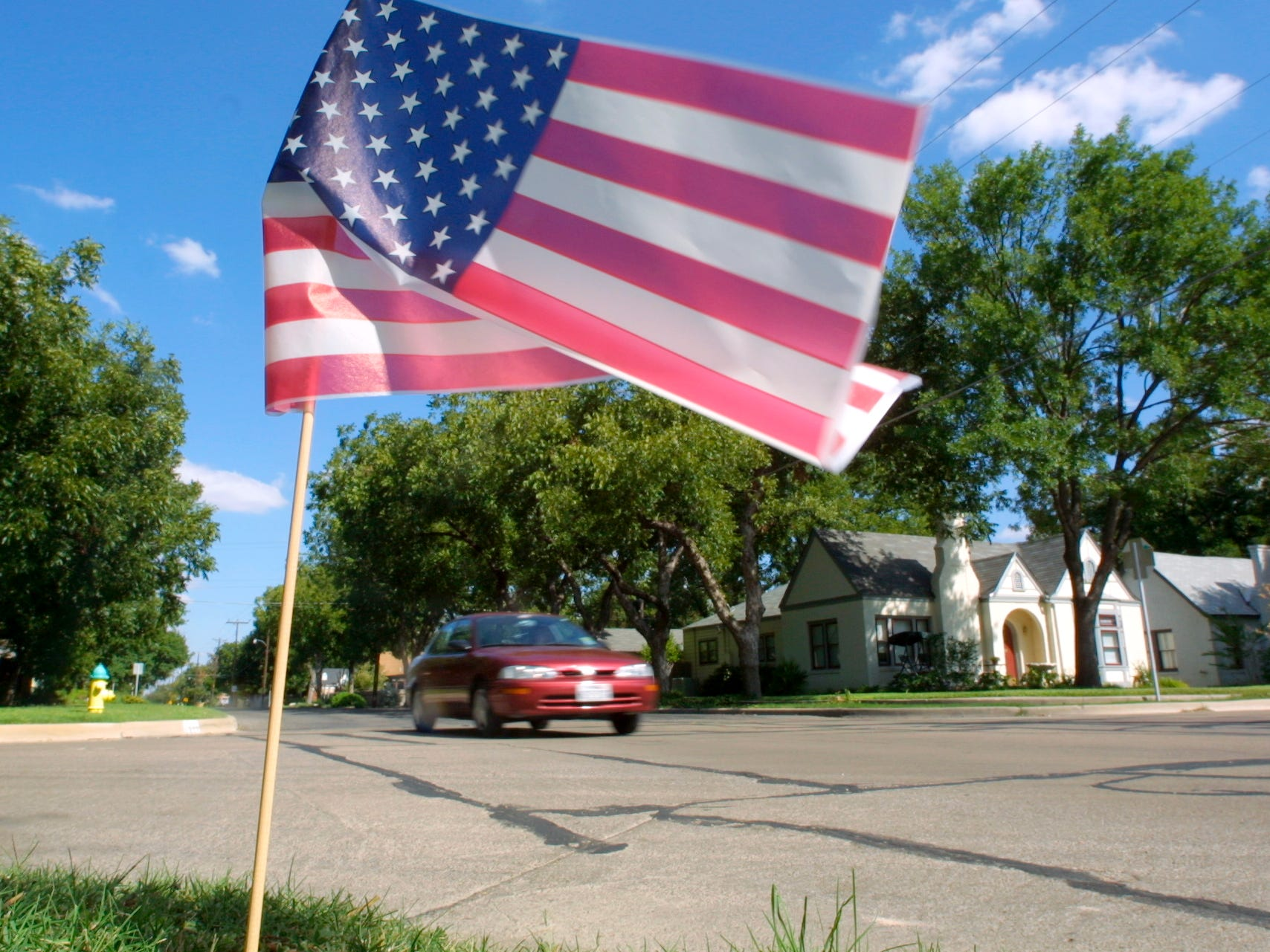 An American Flag stands in a yard at Mackenzie and W. Avenue J in San Angelo on Sept. 12, 2001. Residents began flying flags in support of their country after the previous day's terrorist attacks.