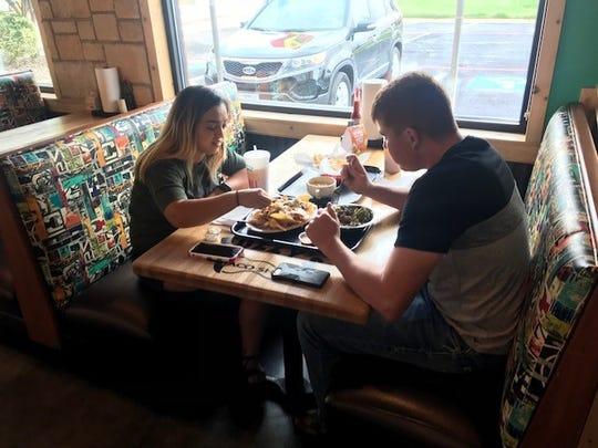Janai and Matthew Gloria enjoying some nachos Monday, Sept. 10, 2018 at Fuzzy's Taco Shop, 4333 Sherwood Way.