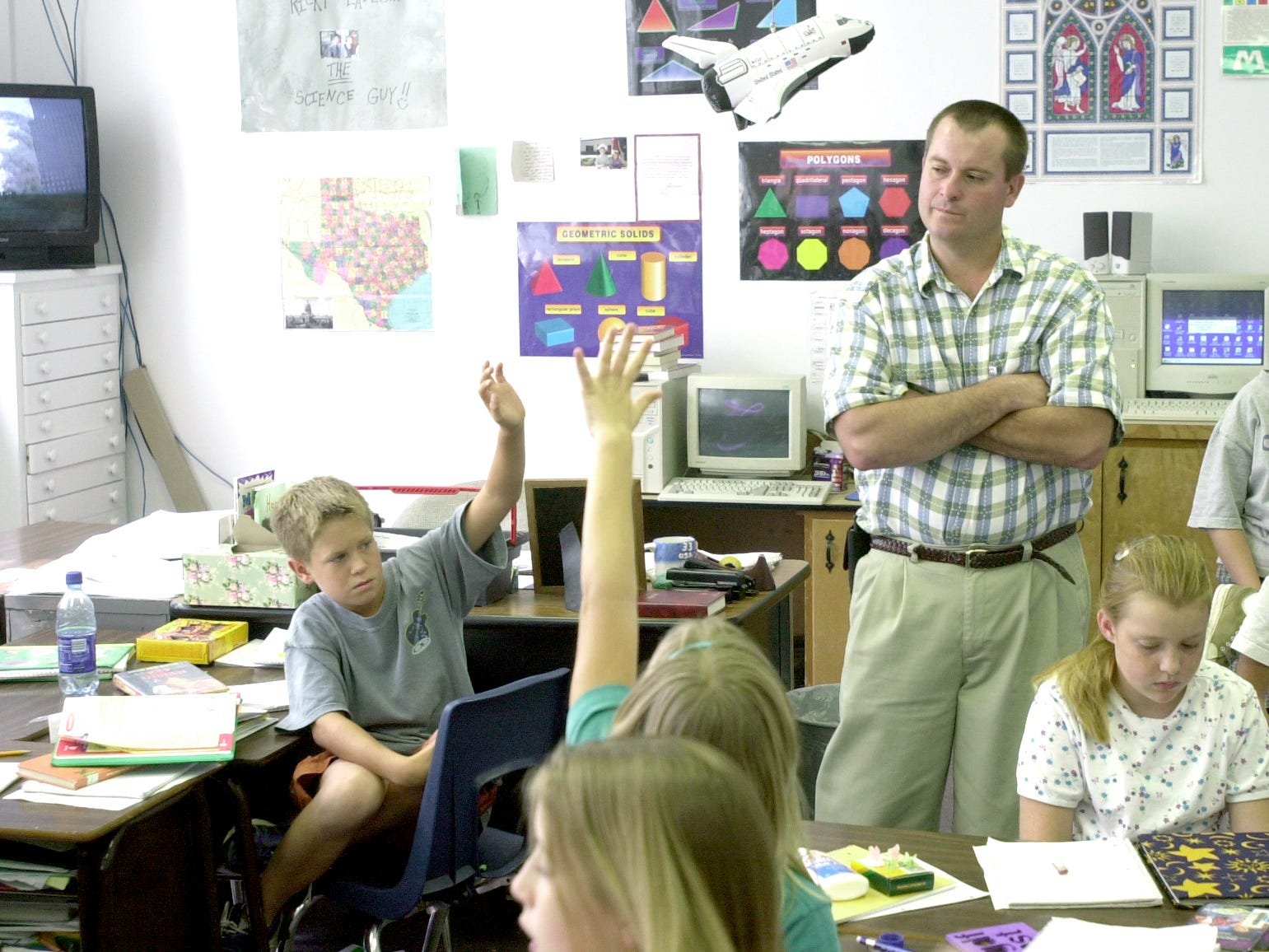 Ricky Eades' listens to his fifth grade class at Santa Rita Elementary talk about the World Trade Center attacks during a current events discussion Sept. 11, 2001.