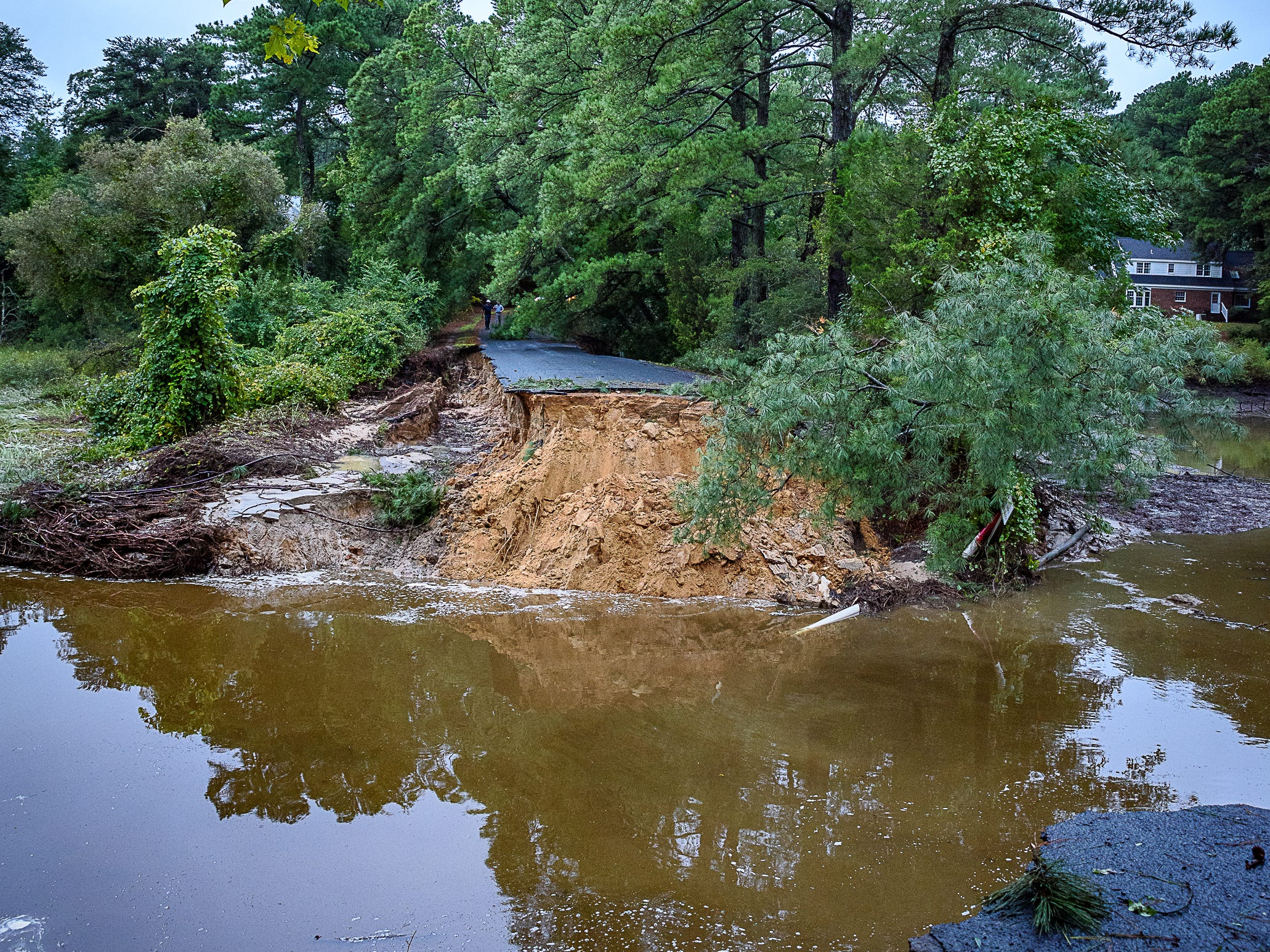 Heavy rains overnight washed out the only road leading into the Hillsborough neighborhood in Belle Haven in Accomack County. The area is bracing for significant impact from the approaching Hurricane Florence.