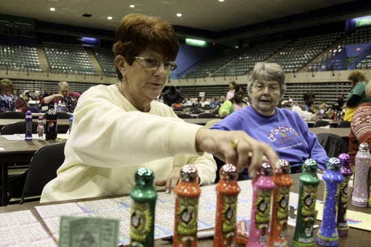 Deanna Thistlewood, front, and Betty Graham play bingo at a previous Bingomania held at the Wicomico Youth & Civic Center.