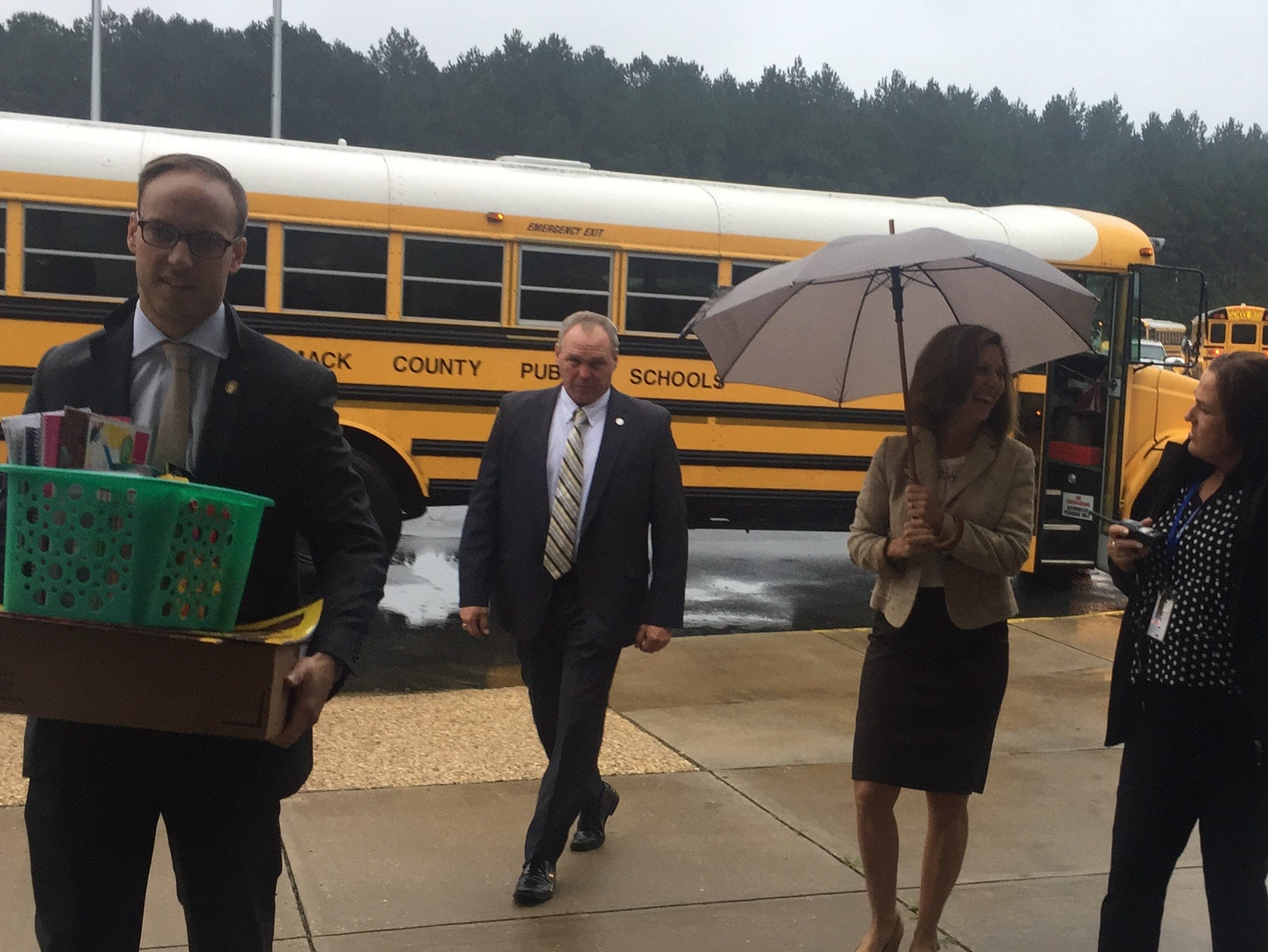 Virginia First Lady Pamela Northam, with umbrella, enters Accawmacke Elementary School in Daugherty, Virginia on Monday, Sept. 10, 2018.