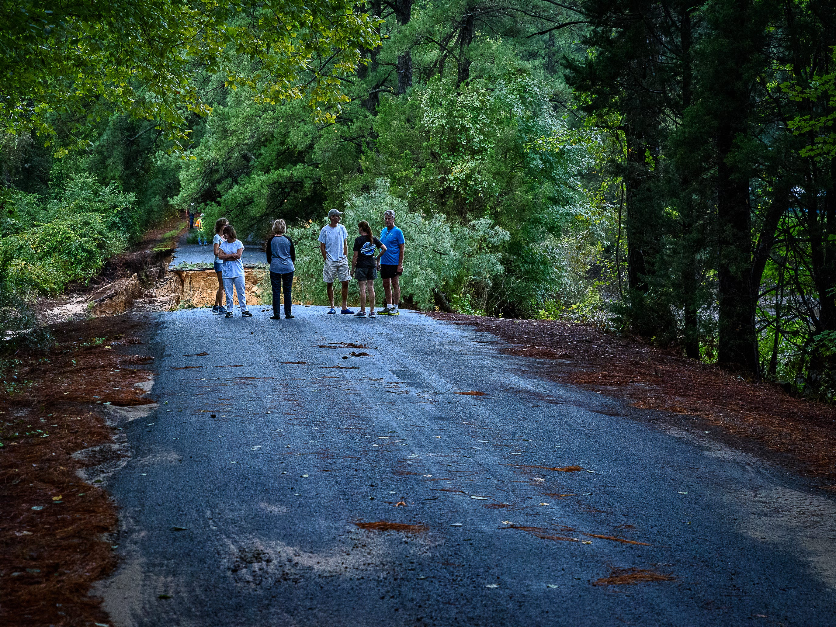 Residents of  Hillsborough neighborhood in Belle Haven in Accomack County look at the damage caused by the rain to the road leading into their area on Monday, Sept. 10.