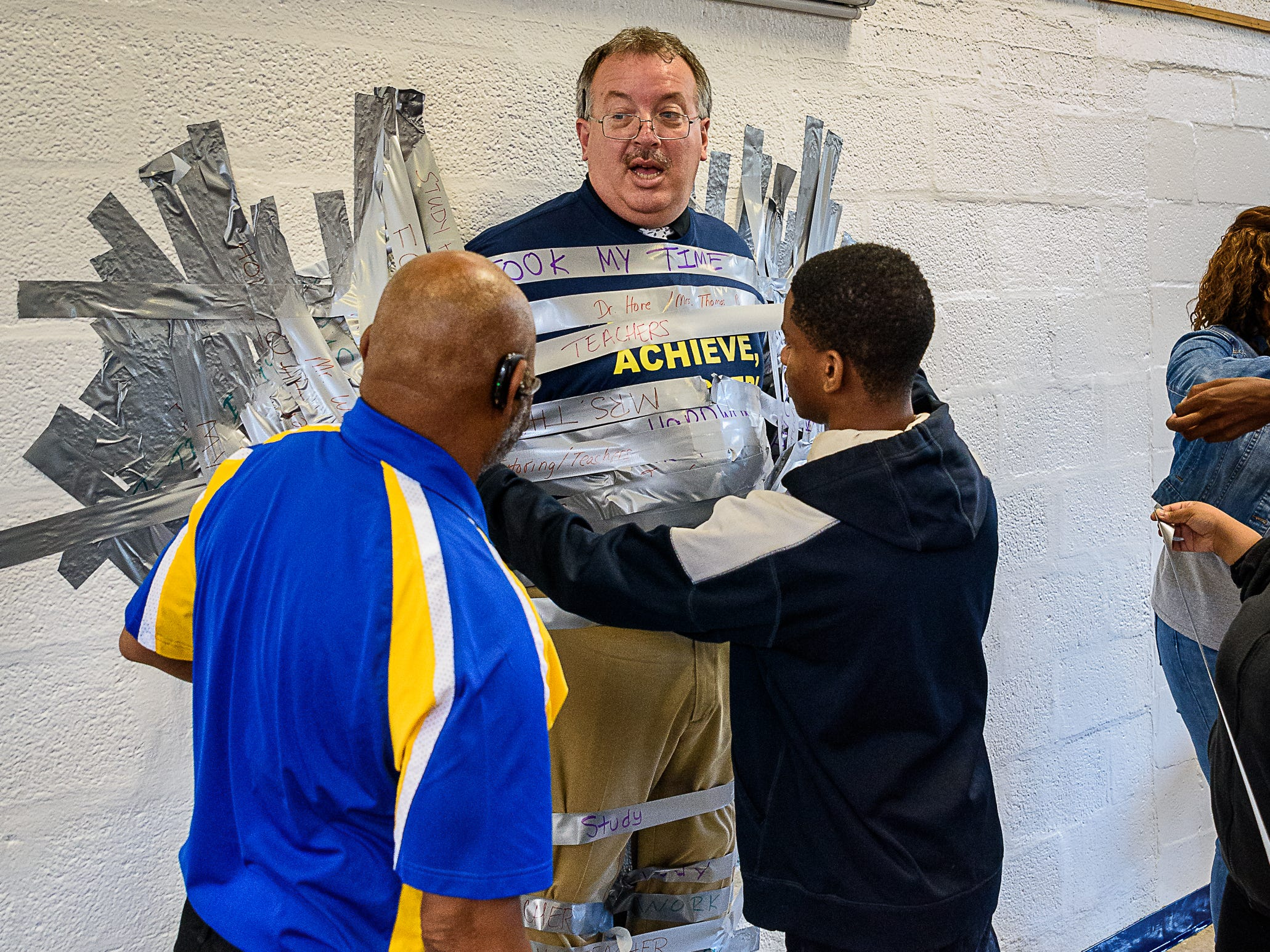Assistant Principal Charles King offers some help to a student.