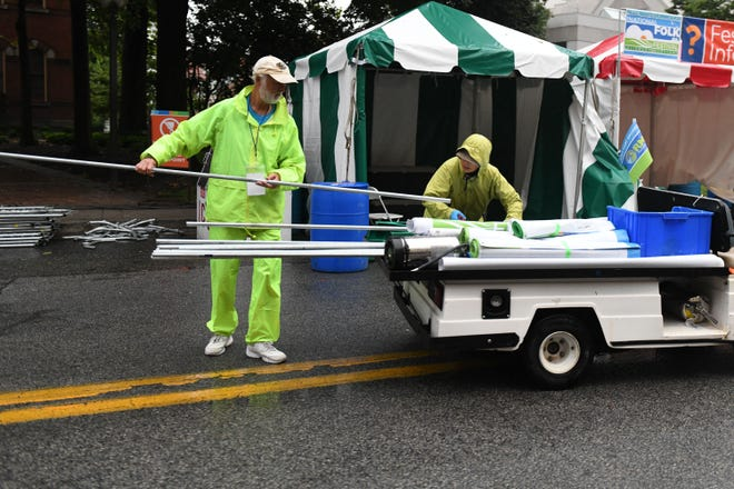 The City of Salisbury clean up after the conclusion of the 78th National Folk Festival on Sunday, Sept. 9, 2018.