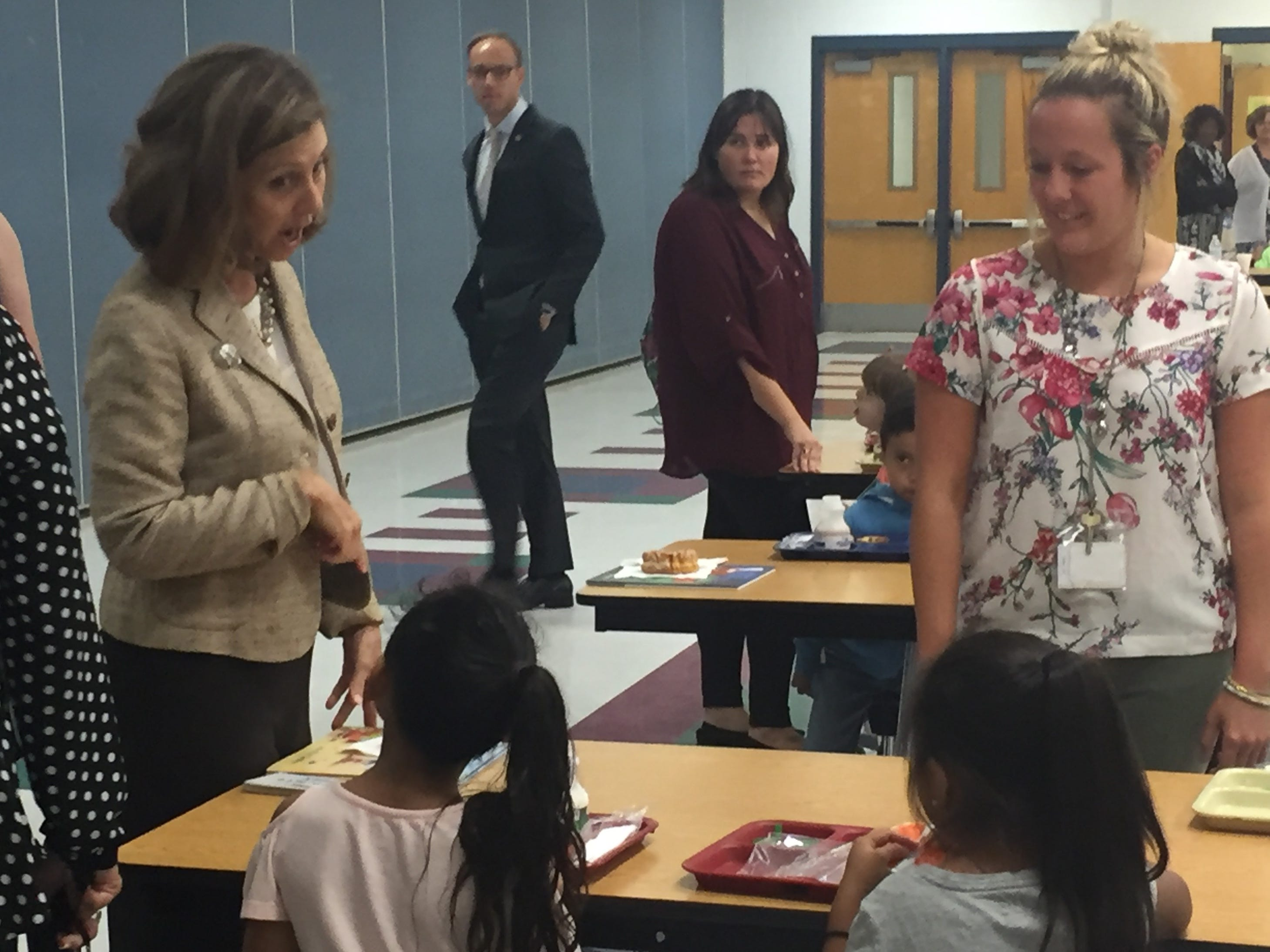 Virginia First Lady Pamela Northam chats with students in the cafeteria during a visit to Accawmacke Elementary School in Daugherty, Virginia on Monday, Sept. 20, 2018.
