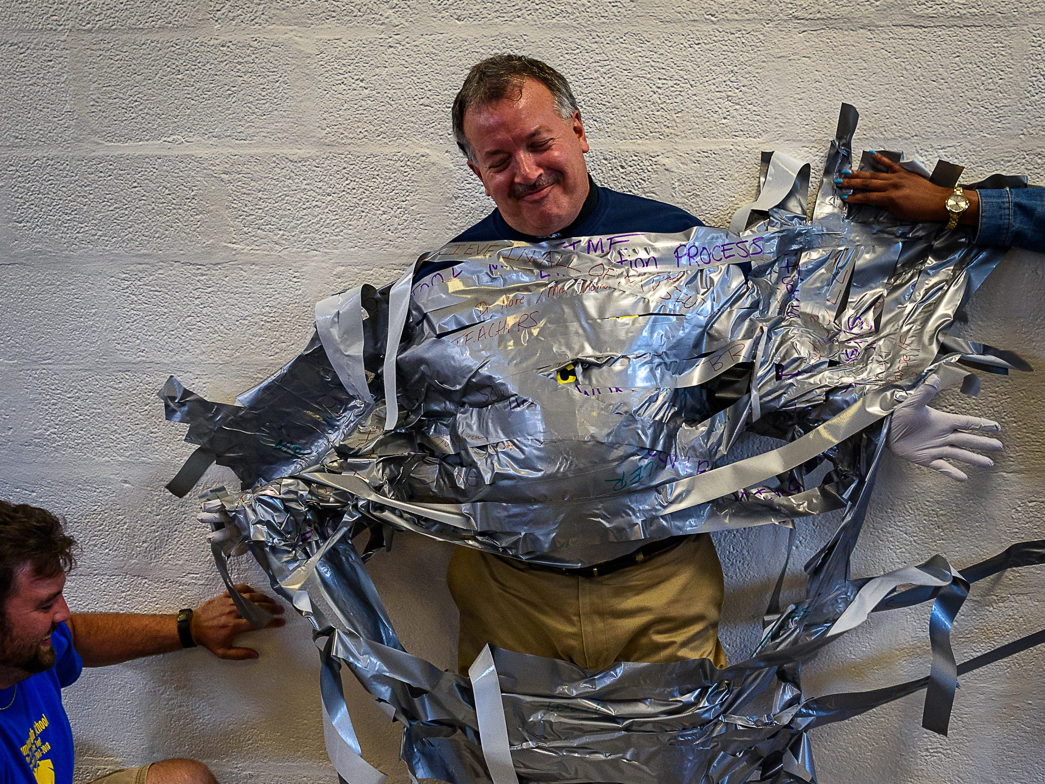 Four rolls of duct tape were not quite enough to hold Principal Mike Myers to the wall at Northampton High School.