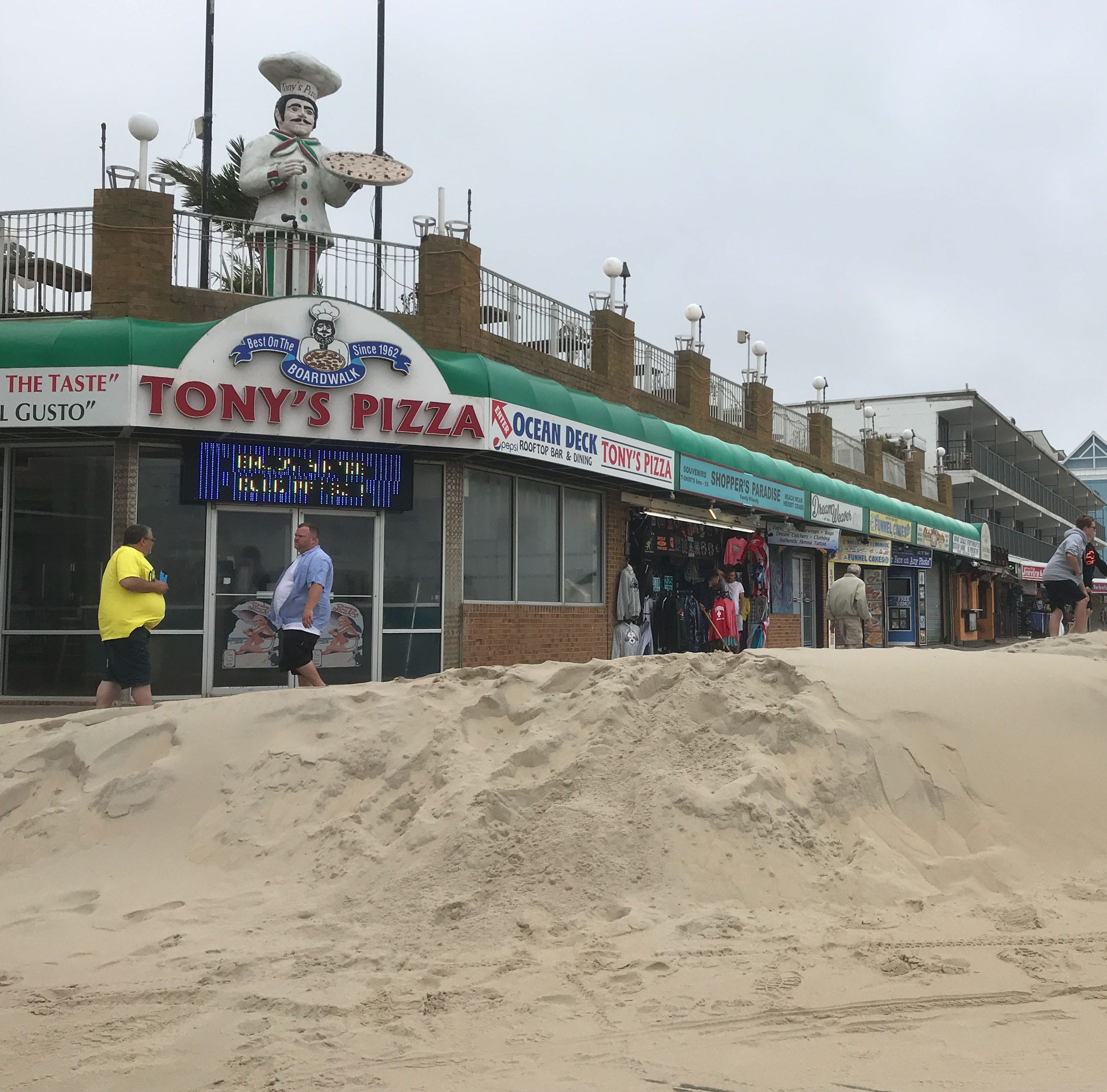 PHOTOS: Rough seas, flooding, sand on boardwalk in Ocean City, Rehoboth