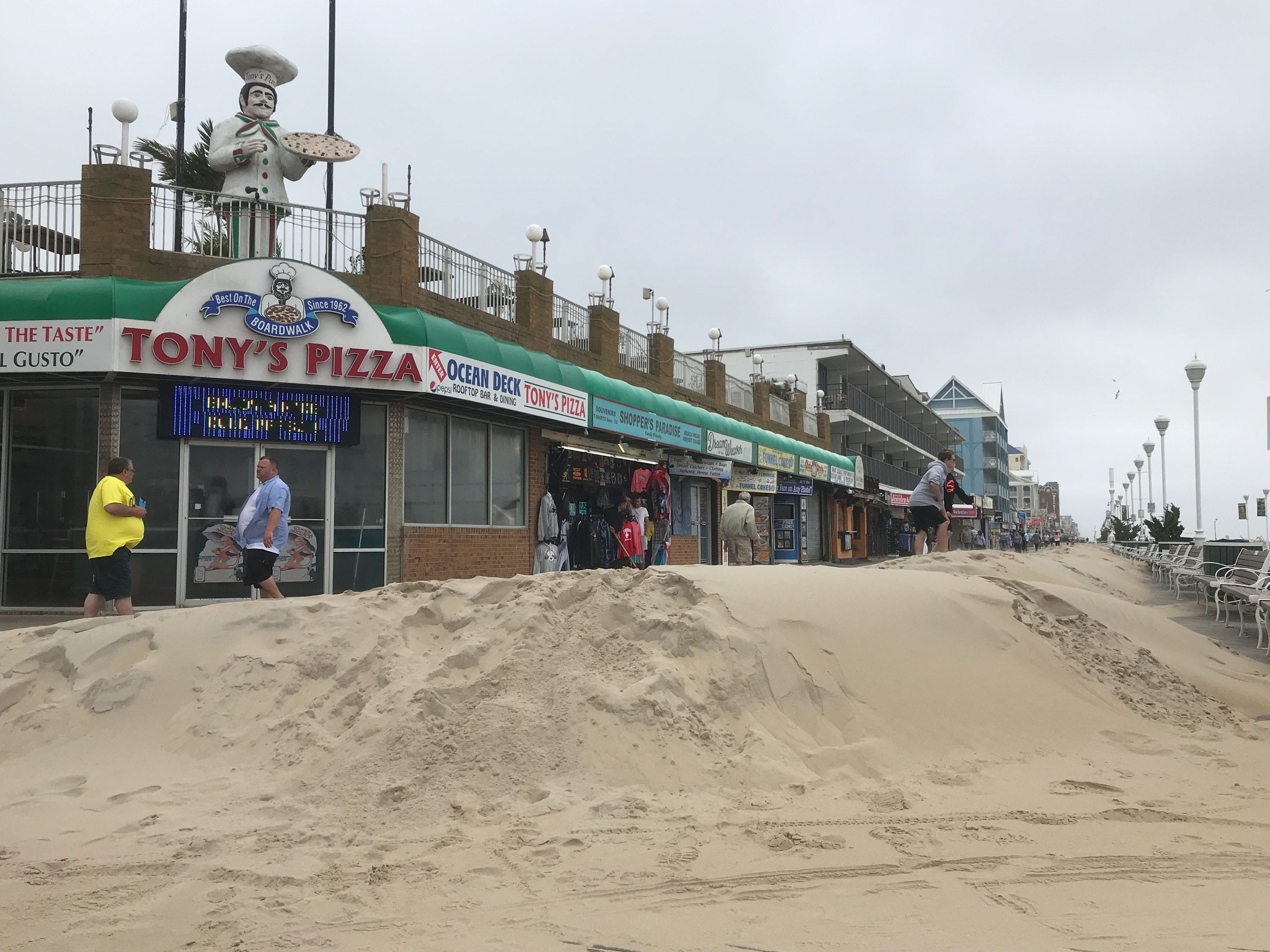 A large amount of sand has accumulated on the Ocean City Boardwalk over night on Monday, Sept. 10, 2018. Clean up is expected to take 2-3 days to clear.