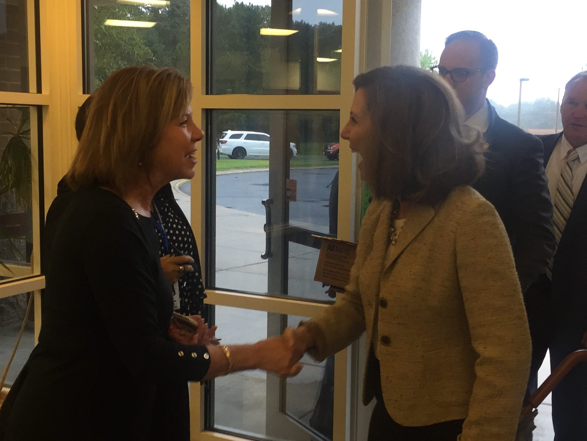 Dawn Byrd, United Way of Virginia's Eastern Shore executive director, left, greets Virginia FIrst Lady Pamela Northam at Accawmacke Elementary School in Daugherty, Virginia on Monday, Sept. 20, 2018.