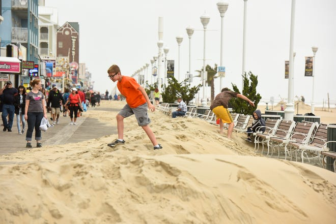 Piles of sand washed up onto the boardwalk in Ocean City, Maryland on Monday, Sept. 10. The sand will likely take two to three days to clean.