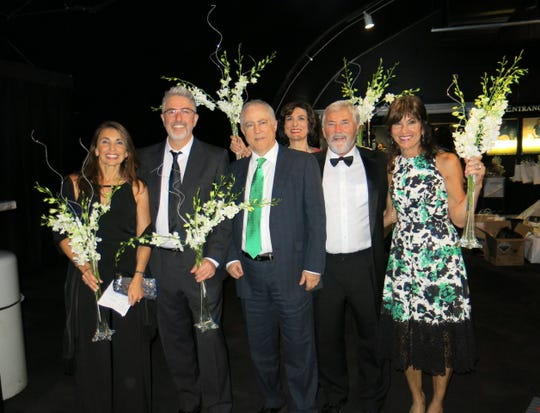 Symphony Gala-goers leaving with gifts of centerpieces: Drs. Andrea and Guillermo  Sangster, Drs. Jose and Ana Alba and Paul and Tina Broussard