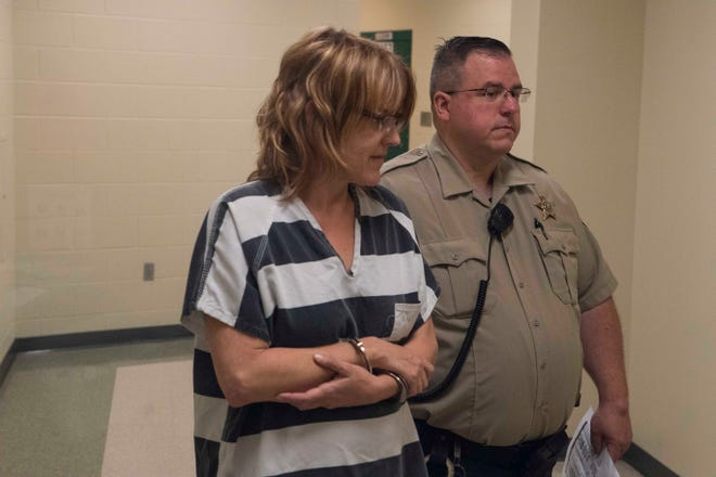 Jayme Kae Knudson is escorted into the courthouse from Minnehaha County Jail on Monday, Sept. 10, 2018 in Sioux Falls, S.D.