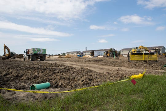 Construction is shown on E 57th Street and S Dubuque Avenue in Sioux Falls, S.D. on Monday, Sept. 10, 2018.