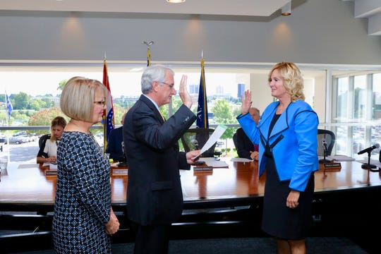 Paula Adams was sworn in Monday to a position on the OTC Board of Trustees vacated by Chip Sheppard. She is worn in by Greene County Judge Calvin Holden while board chair Jennifer Kennally.