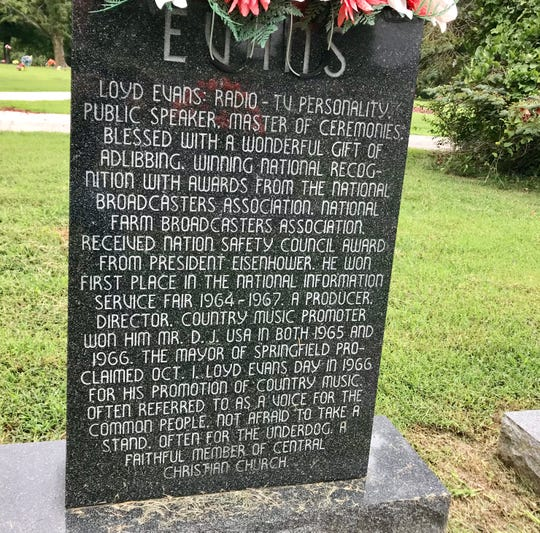 The other side of the headstone gives a bio of Loyd Evans.