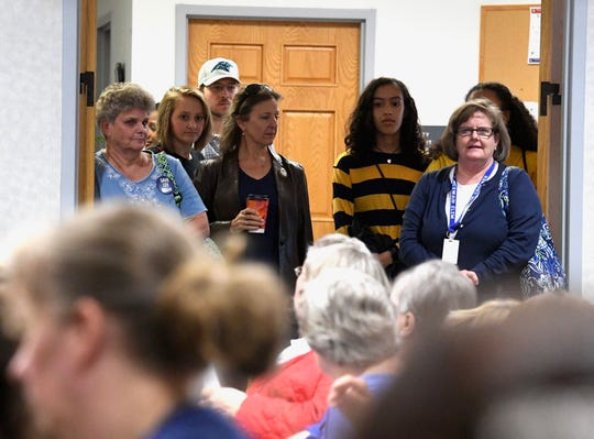 Attendees wait outside the at-capacity meeting room as the diversity study is presented to the Staunton City School Board