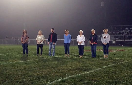Riverheads' 2018 Hall of Fame includes, from left, Marsha Carwell Smith, Ali Painter Engleman and Logan Moore. Also inducted were Riverheads coaches Gene Wassick, Mike Hemp, Ray Norcross and Robert Casto. Standing in for them are their wives June Wassick, Katrina Hemp, Alisa Norcross and Chris Casto.  Not pictured is inductee Mary Hemp Hubbard.