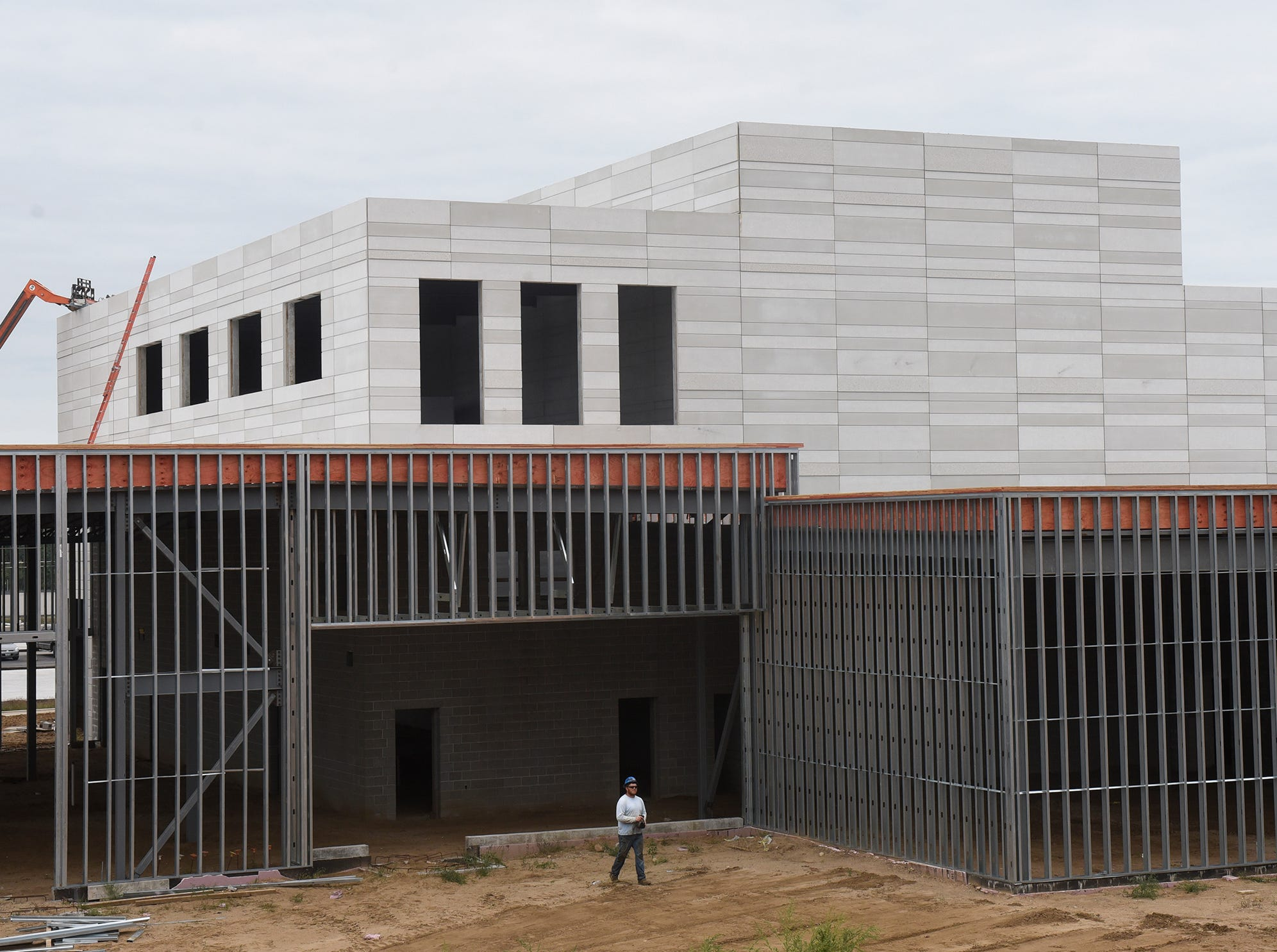 The outer wall coverings are being put into place and framing work continues near the auditorium area Monday, Sept. 10, at the new Tech High School site in St. Cloud.