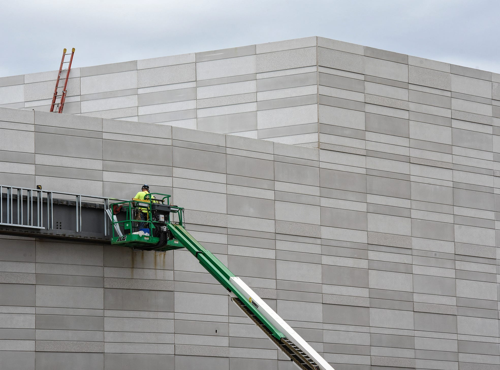 The exterior covering of the new Tech High School building takes shape Monday, Sept. 10.