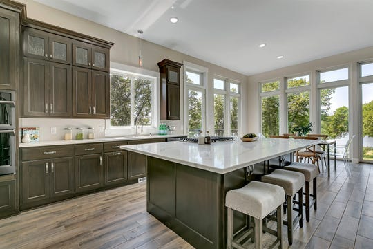 The kitchen's 8-foot quartz top island, stainless steel appliances and double wall oven is a cook or baker's paradise.