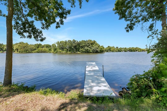 A gradual sloping lawn leads to the dock.