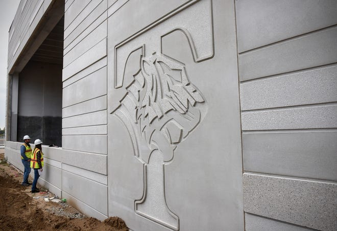 The Tech logo is featured near the main entrance Monday, Sept. 10, at the new Tech High School site in St. Cloud.