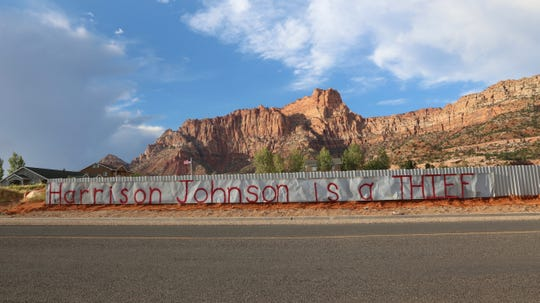 """A sign that reads """"Harrison Johnson is a thief"""" was posted on Utah Avenue in Hildale on Sept. 4, 2018. Thomas Steed said he posted it after a propane tank on their property was taken by Utility Manager Harrison Johnson and other city employees that day. Johnson said records show the tank belongs to the city. The sign was taken down Sept. 19 when the tank was returned."""