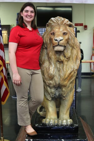 Student School Board Representative Ashley Campbell stands with the lion at Leon High School on Sept. 10, 2018. Campbell will act as a liaison between students and the board.