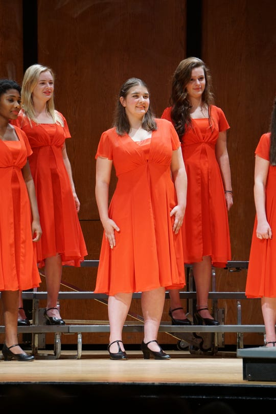 Ashley Campbell (center) performs with Leon High School's Melodears.