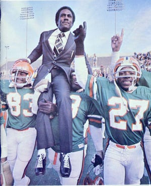 Rudy Hubbard is carried off the field by players. His 1978 team won the NCAA Division I-AA national championship.