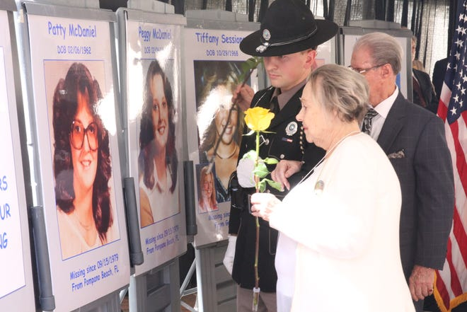 Families of 17 missing children laid flowers on Monday during the annual Florida Missing Children's Day.
