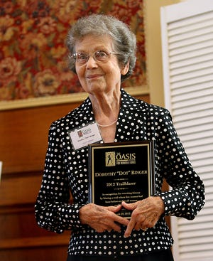 Dorothy Binger holds her award as The Oasis Center for Women and Girls recognizes local women who have rewritten history by blazing trails. The 2012 Trailblazers were honored at the Women's History Month Community Luncheon at on  Thursday at the Lively Cafe in St. John's Church.