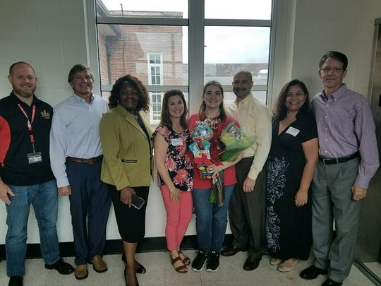 Ashley Campbell (center) with friends, family, Leon High School staff and Leon County administrators on the day she was announced as the 2018-19 Student School Board representative.