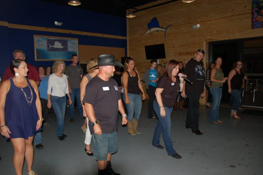 The sixth annual Wild Roses Workshop & Social Dances is Saturday at the River Walk Center in Fort Pierce. The team is pictured here line dancing at Sailfish Brewing Company.