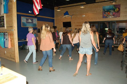 More than 30 people went to the first free line dancing night Aug. 10, 2018, at Sailfish Brewing Company in Fort Pierce.