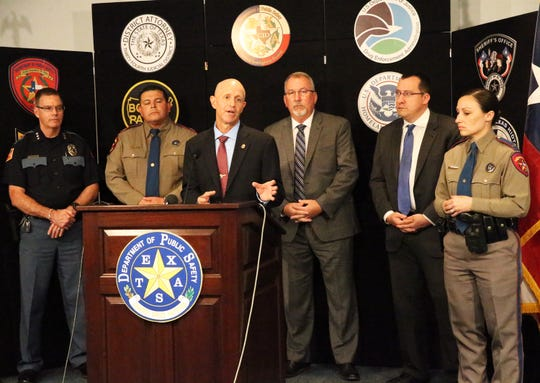 Kyle Williamson, center, Special Agent In Charge of the Drug Enforcement Administration El Paso Division speaks at a press conference with other law enforcement officials Monday.