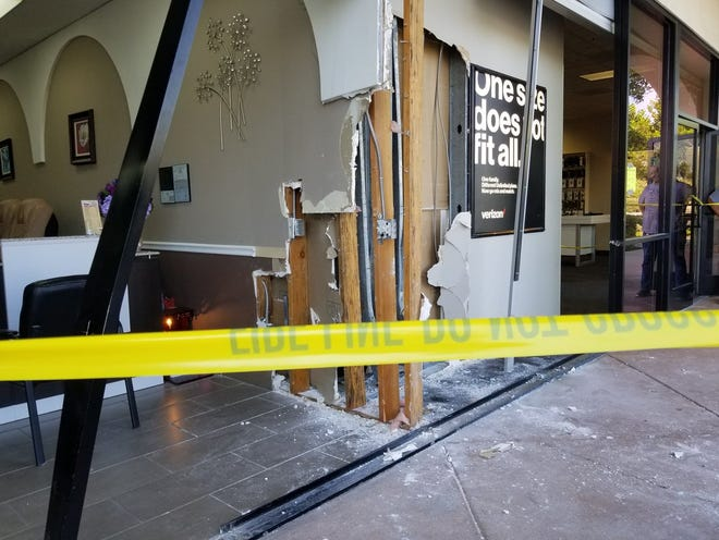 Part of a glass wall is missing after a vehicle crashed into a business in a shopping center Monday afternoon in Camarillo.