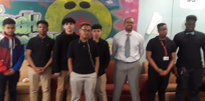 The Boys and Girls Club of Vineland's Passport to Manhood represents a targeted effort to engage males in discussions and activities that reinforce character, leadership and positive behavior. As part of the program, Educator Darren Palmer (third, from right) recently spoke to young men at the club about being presentable and knowing who you are. This included lessons on delivering a proper handshake and dressing well for a job interview. For club information, call (856) 696-4190 or visit www.vinelandbgc.org.