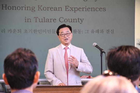Pastor Kwon Young Ko of Fresno Korean Presbyterian Church leads an opening prayer.