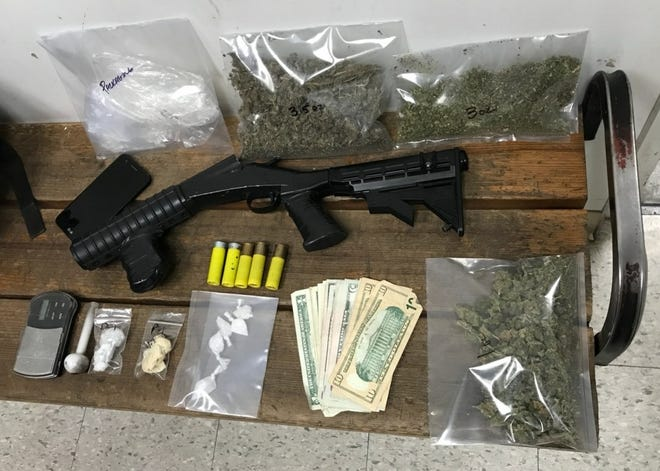 Visalia police said they found drugs and a sawed-off shotgun during a traffic stop Sunday night.